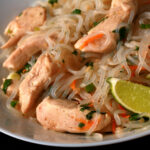 A plate of paleo chicken pad thai, made with shirataki noodles.