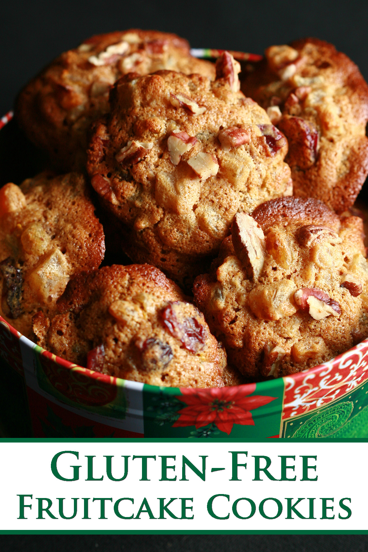 """https://celebrationgeneration.com/wp-content/uploads/2011/12/Gluten-Free-Fruitcake-Cookies-Pinterest.jpg"""" alt=""""A festive green and red holiday container is full of cookies. The cookies have visible pieces of fruits and nuts throughout."""