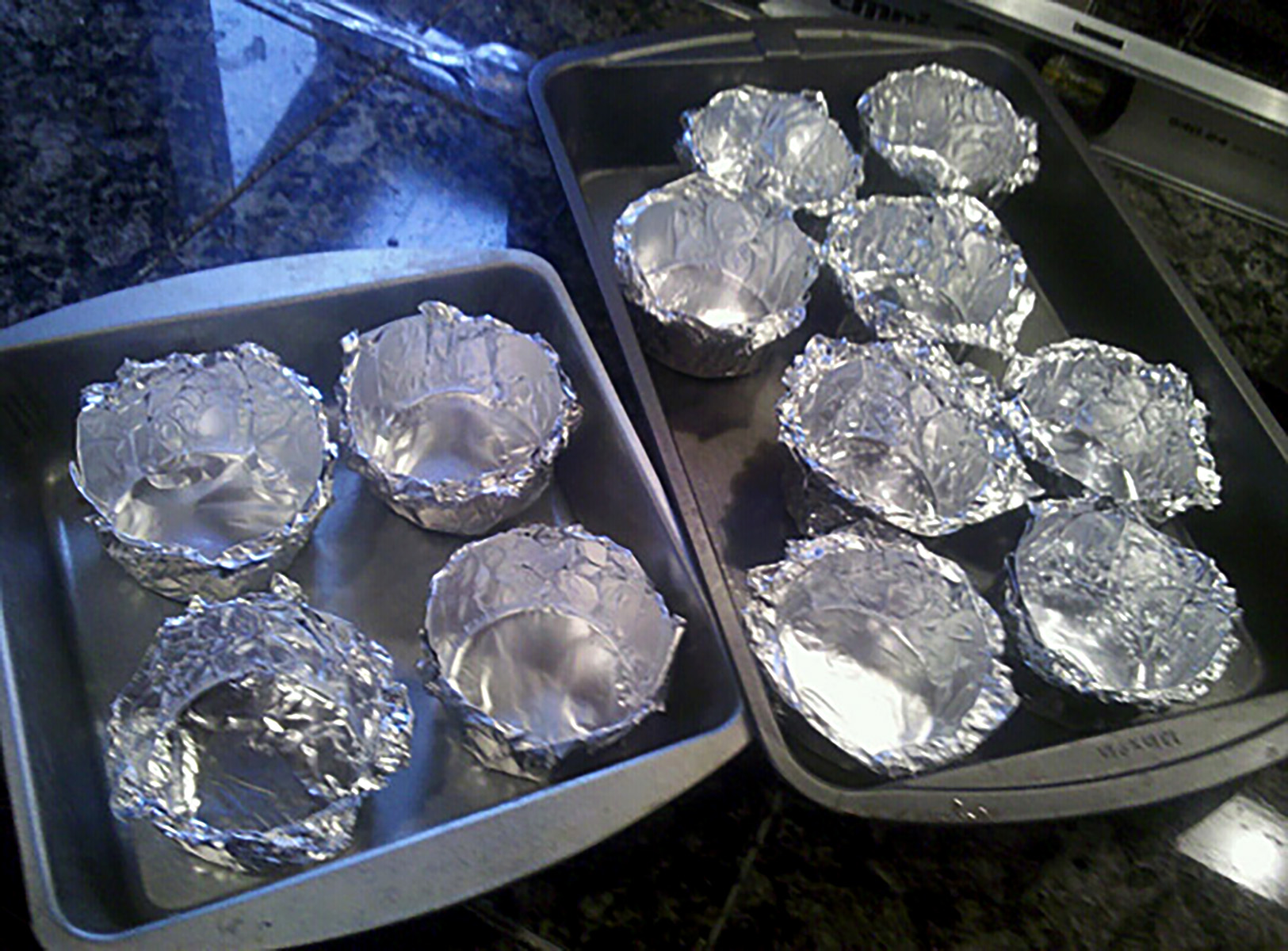 Homemade foil cuts, arranged in baking pans.