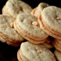 A small brown plate piled with oatmeal sandwich cookies, with a peanut butter filling - Gluten-Free Do-Si-Dos!