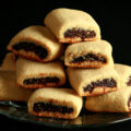 A small glass plate piled high with gluten-free fig newtons.