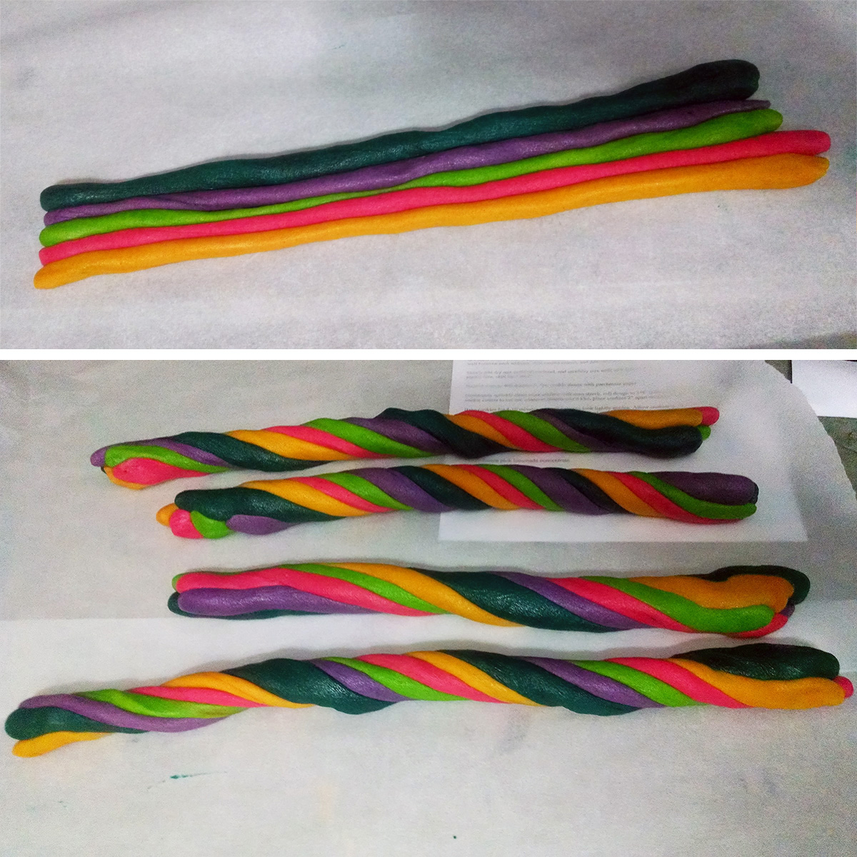 Long ropes of pink, yellow, green, teal, and purple cookie dough are lined up and twisted around each other.