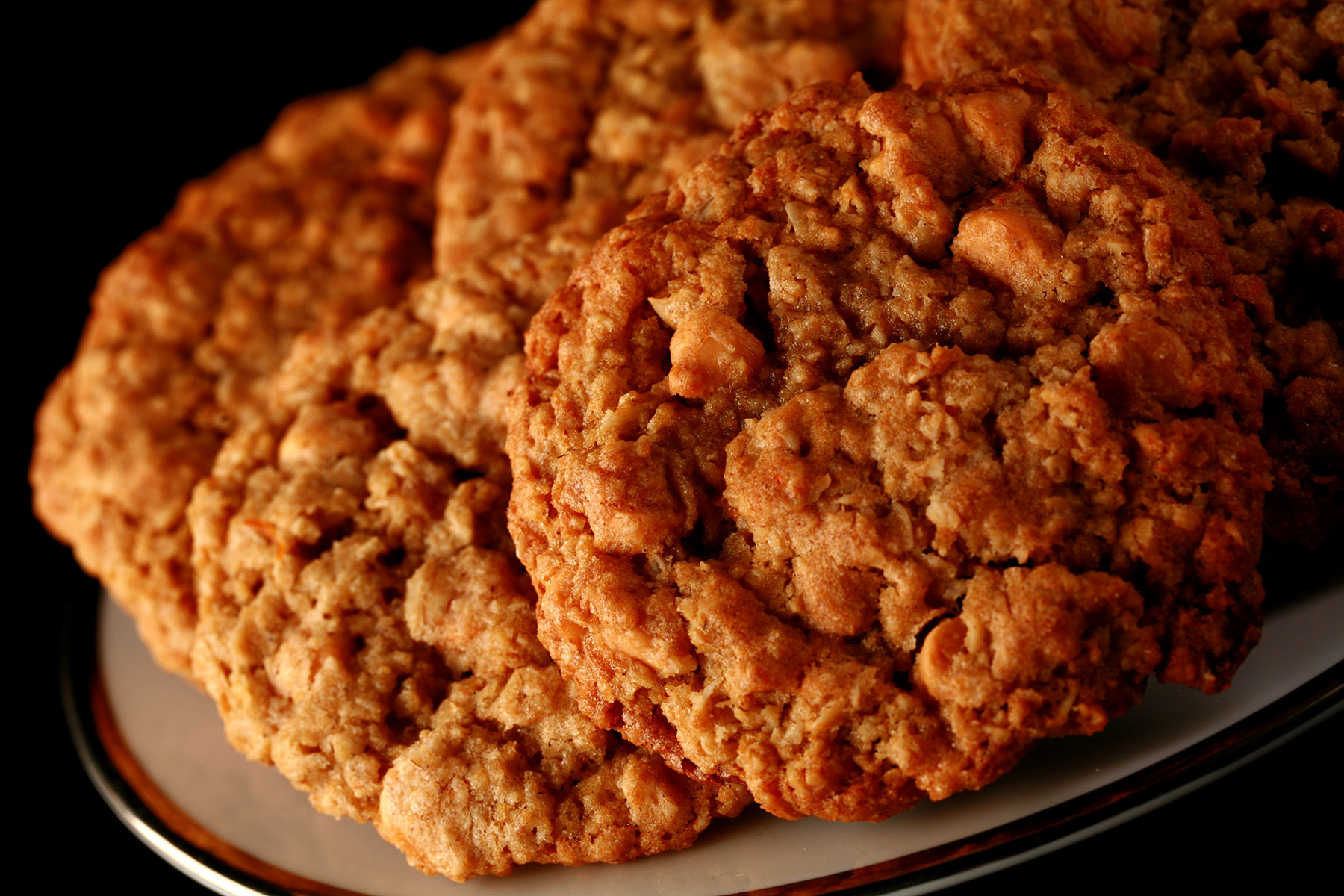 Close up photo of a plate of gluten-free oatmeal cookies with visible butterscotch chips