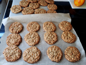 A tray of freshly baked butterscotch oatmeal cardamom cookies.