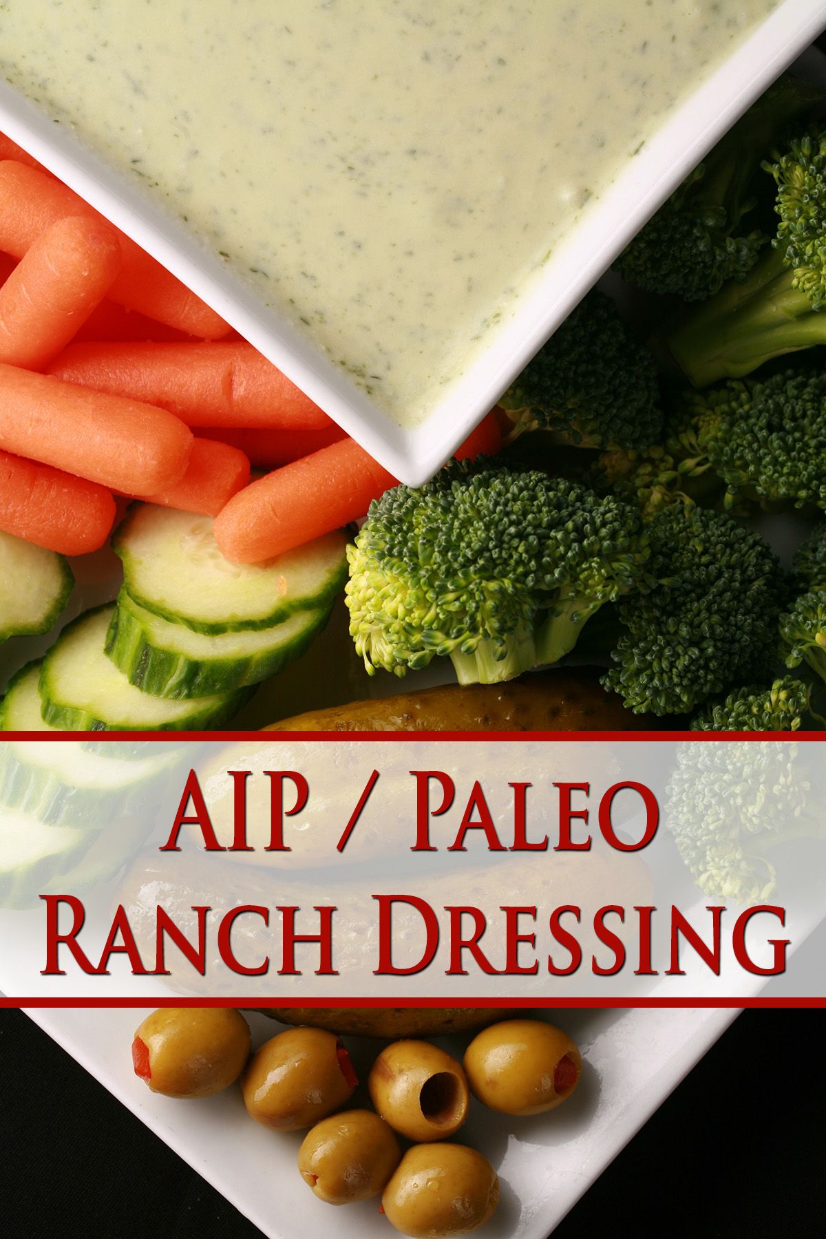 A bowl of AIP Ranch dressing, surrounded by cut vegetables.