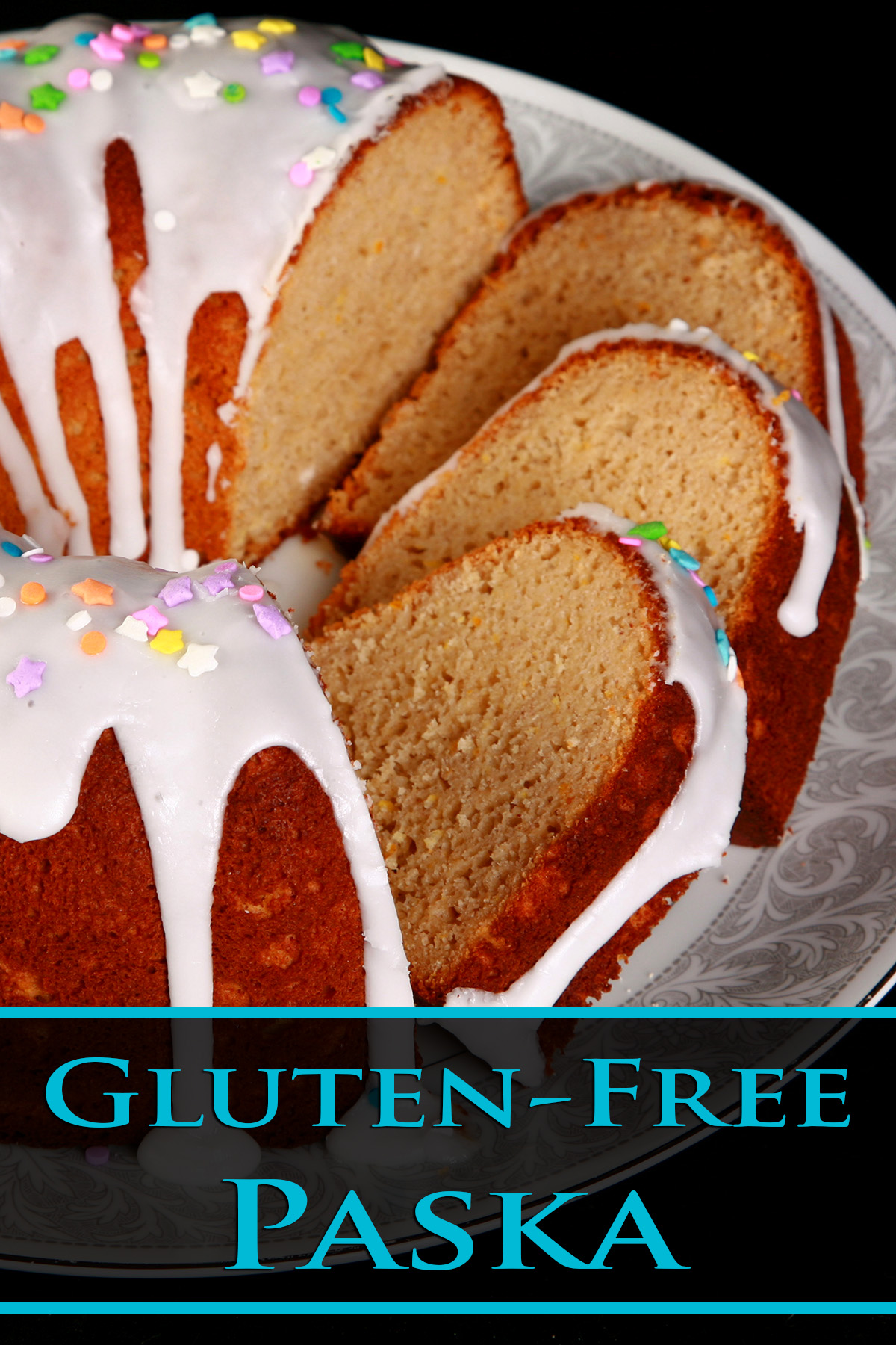 A close up view of a gluten-free paska. It's in the shape of a bundt pan, with dripping white glaze and topped with pastel coloured sprinkles. A section has been sliced, the slices are fanned out on the plate.