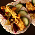 3 cassava tortillas topped with Paleo chicken shawarma, pickled beets, and cucumber slices.