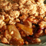 A plate with a generous serving of gluten-free Brandied Apple Crisp.