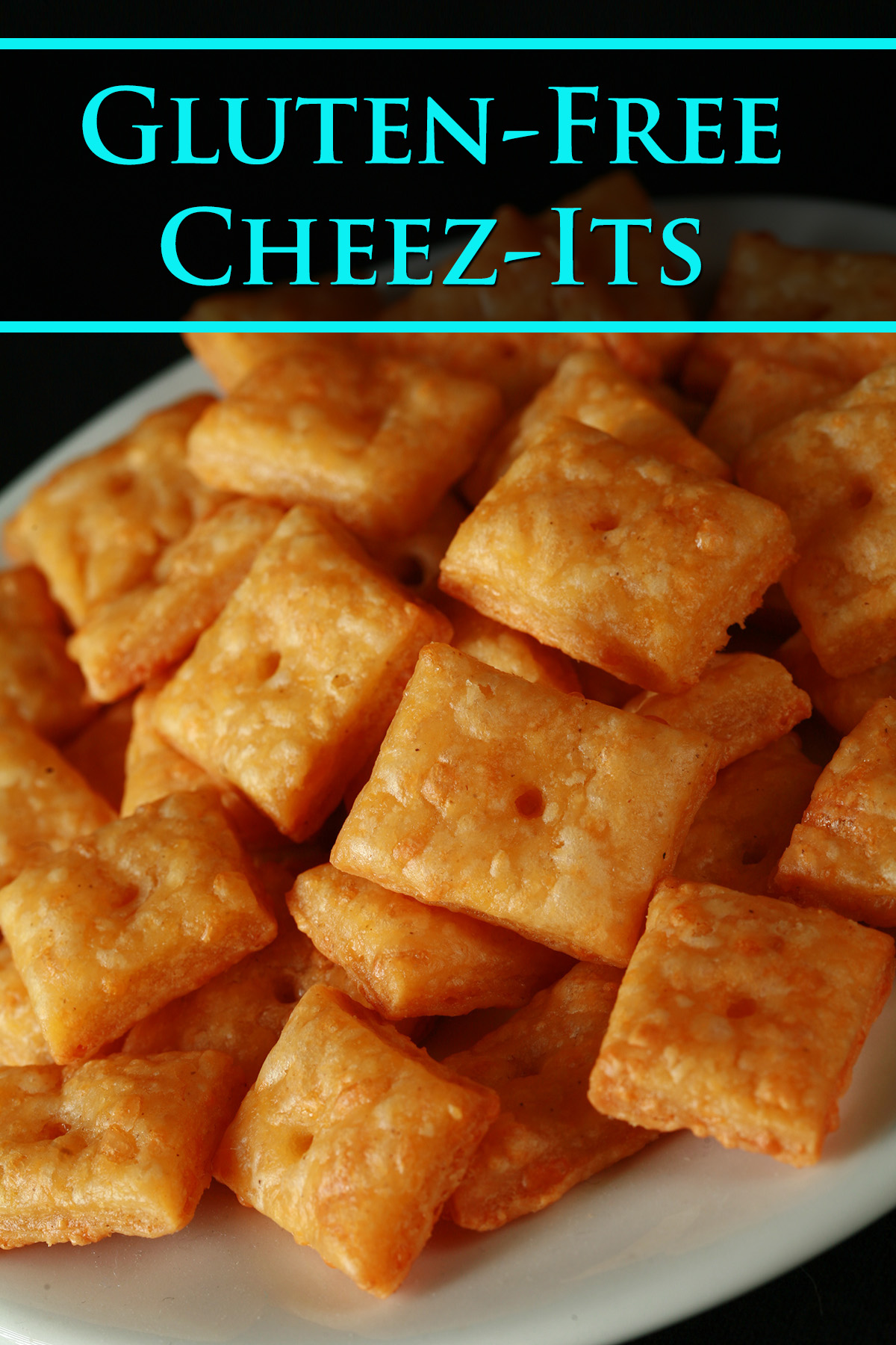 A pile of gluten-Free Cheez-its - little square gluten-free cheese crackers.