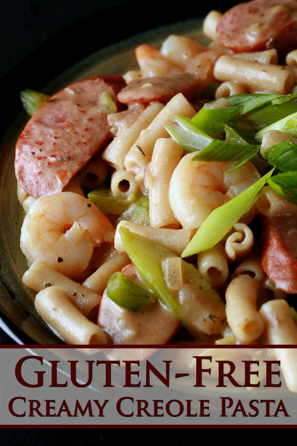 A plate of gluten-Free Creamy Creole Pasta.  Shrimp, chicken, sausage, and celery are visible.