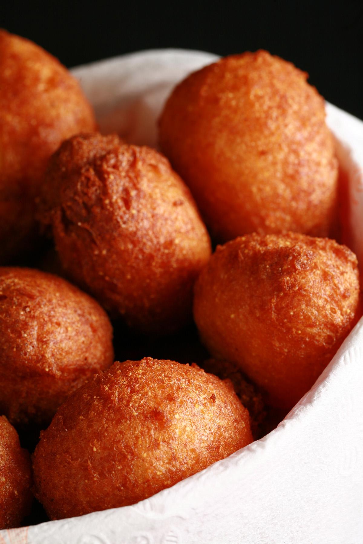 A bowl of gluten-free hush puppies - little balls of deep fried cornmeal dough.