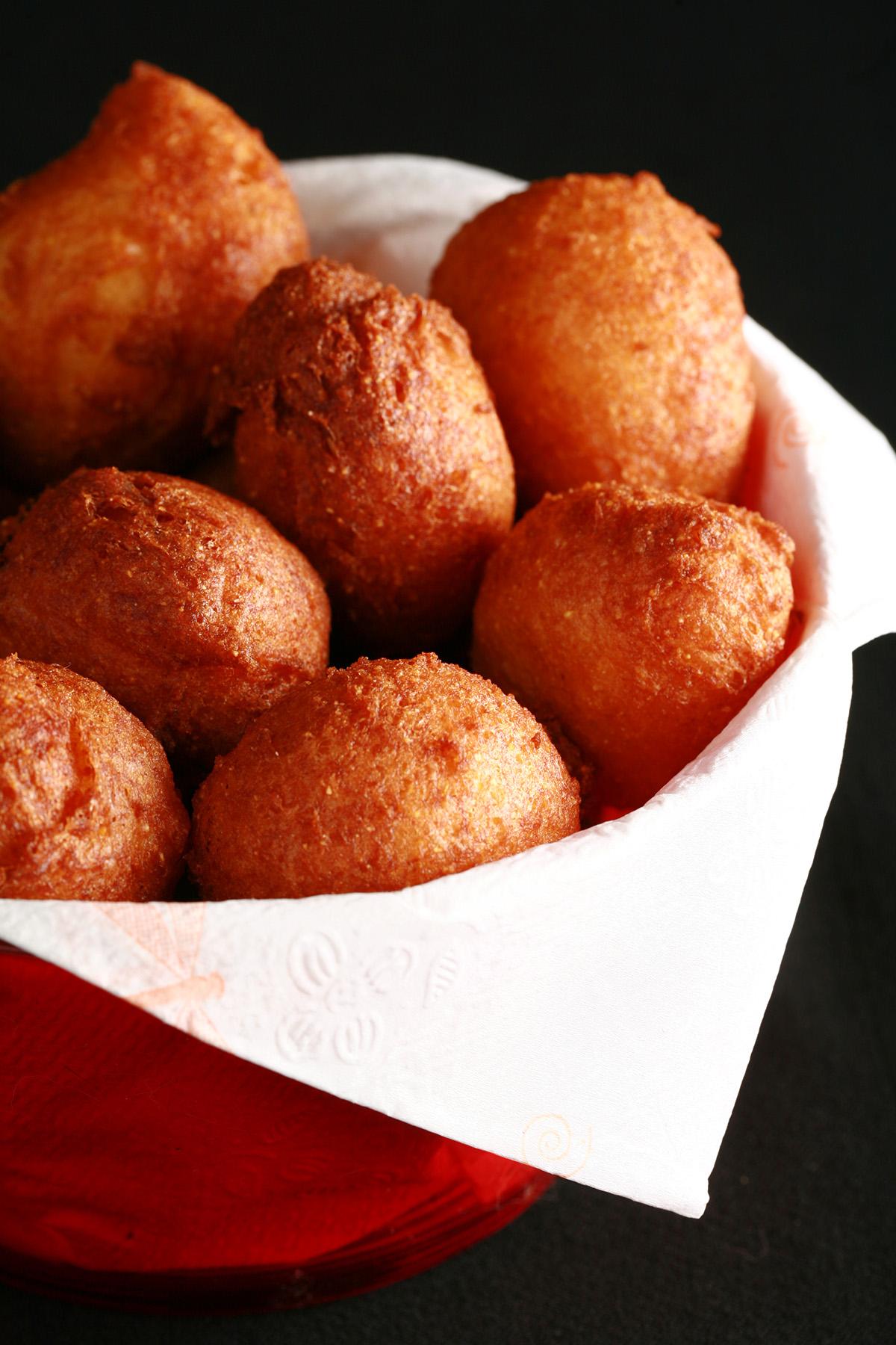A bowl of gluten-free hushpuppies - little balls of deep fried cornmeal dough.