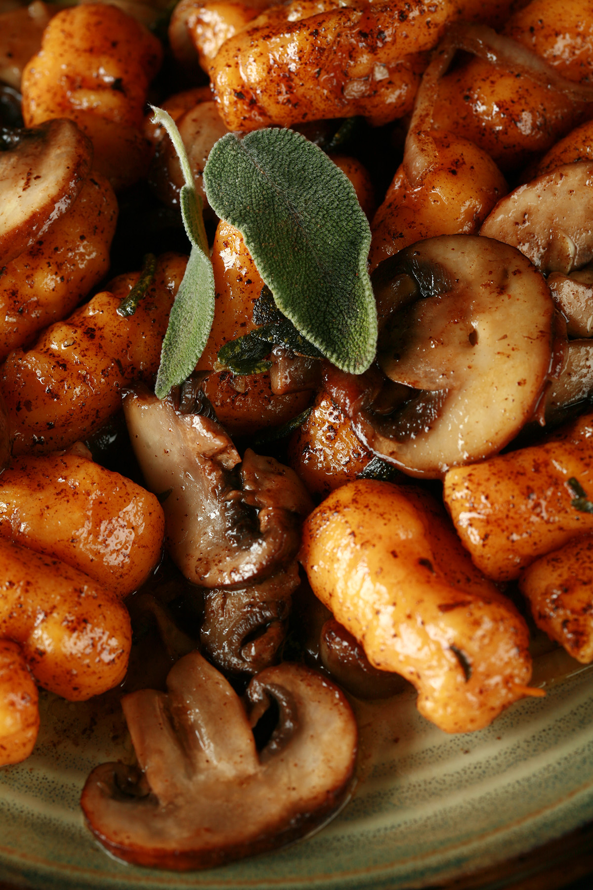 Close up view of paleo sweet potato gnocchi with mushrooms and sage.