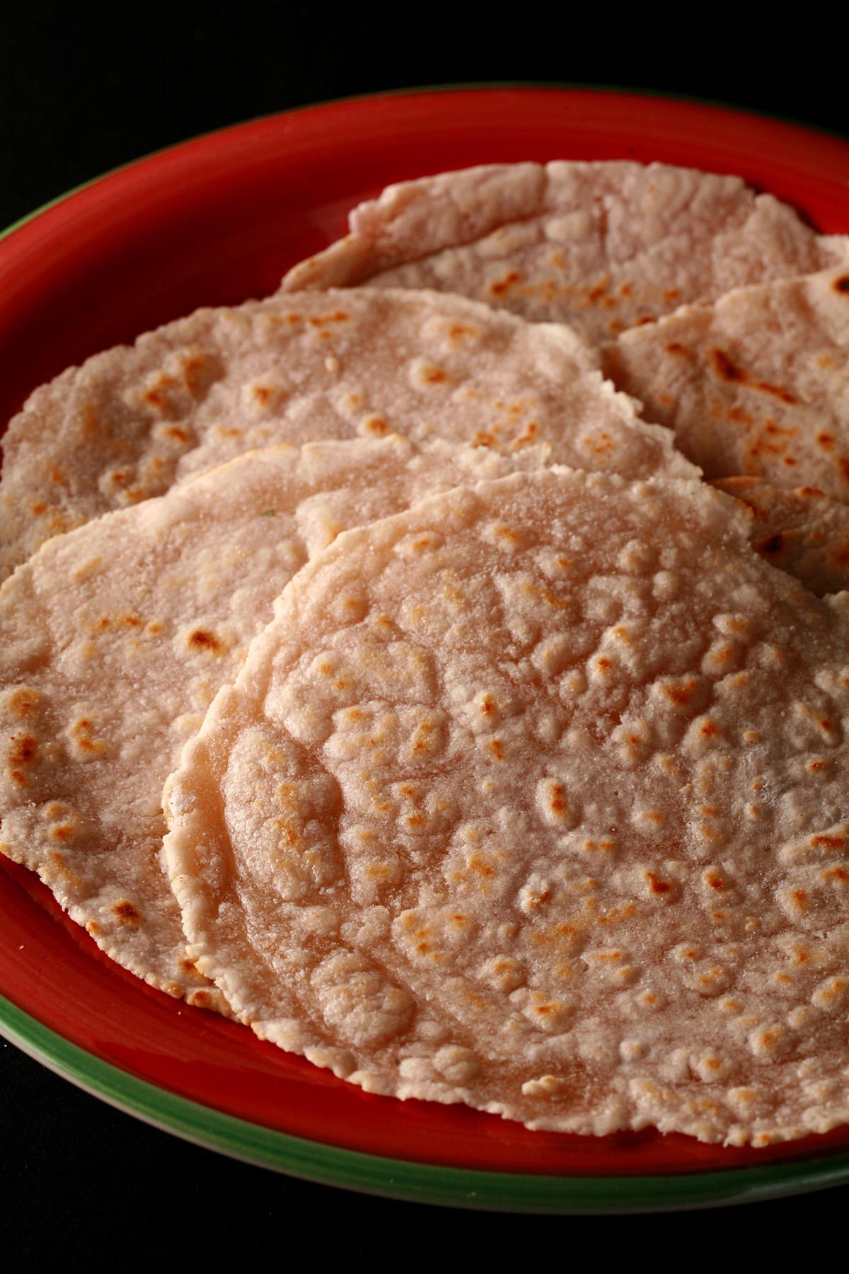 A plate piled with paleo cassava flour tortillas.
